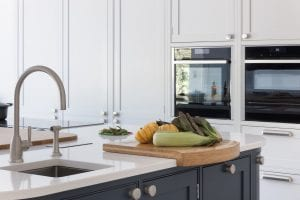 blue island unit with oak chopping board and vegetables
